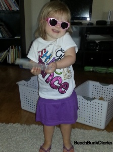 An outfit, flip-flops and sunglasses given by her birth mom.